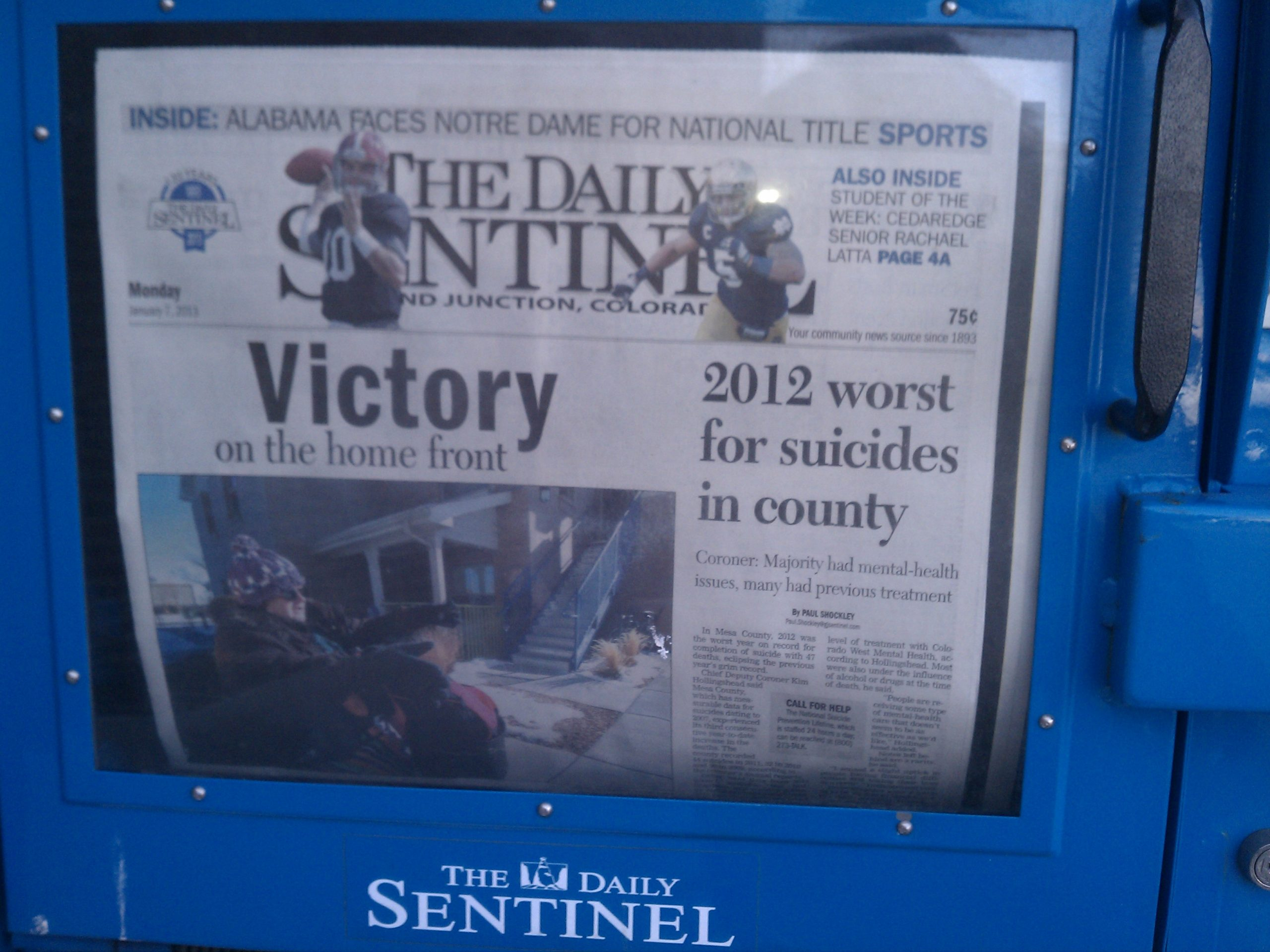 The Grand Junction (CO) Daily Sentinel failed to catch this embarrassing juxtaposition of headlines.