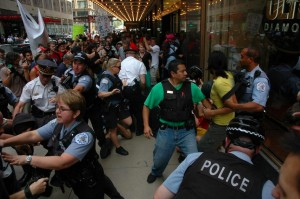 Police tangle with protesters at ALEC's 40th Annual Meeting at the Palmer House Hotel in Chicago in August.