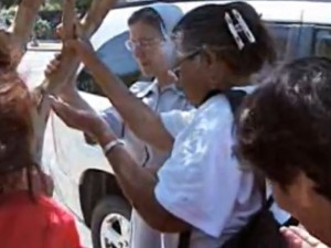Fresno parishioners worship beneath an aphid-infested tree in front of their church (Photo credit: WPTV)