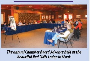 Photo of Chamber Board meeting at a lodge in Utah, printed in the Daily Sentinel.