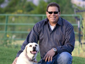 A grinning Rep. Scott poses with a well-fed dog, while hundreds of kids go hungry in Mesa County every week