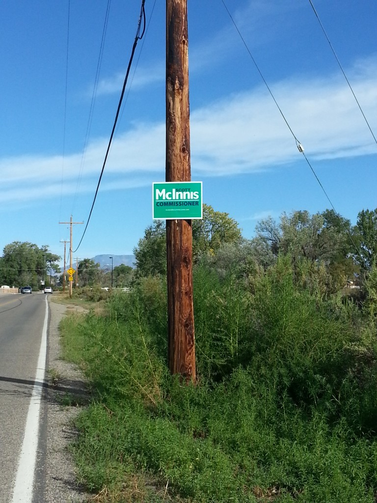 "Illicitly-placed ""McInnis"" campaign sign on a power pole along G Road, placed without permission from XCel. The McInnis campaign has been asked to remove the signs."