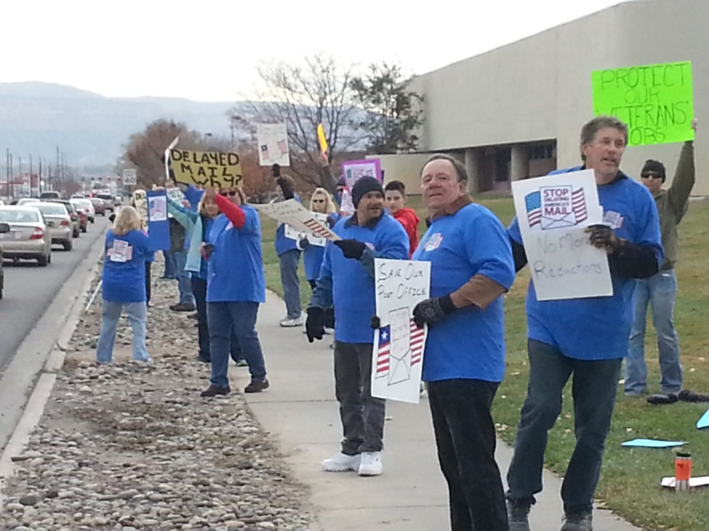 Supporters of the U.S. Post Office in Grand Junction protest further cutbacks at the Patterson Road mail sorting facility on Friday, Nov. 14th.