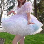 An adult male wearing Sissy Baby clothing