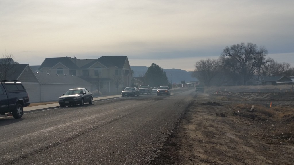 Smoke from an open burning fire smothered an entire neighborhood this afternoon just 1/4 mile from Mesa Mall.