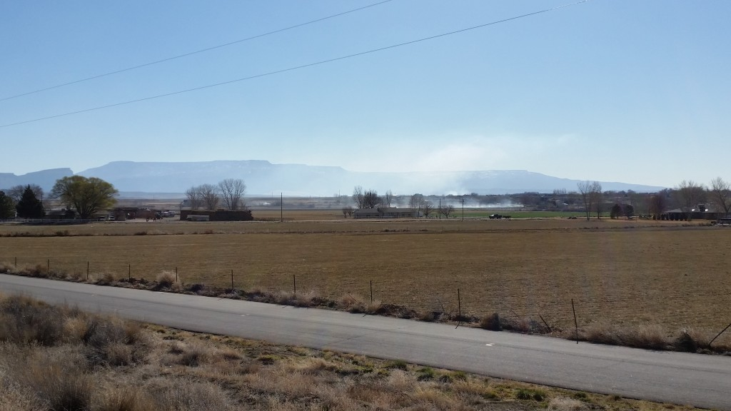 Open burning fills the valley air with haze and envelopes entire neighborhoods