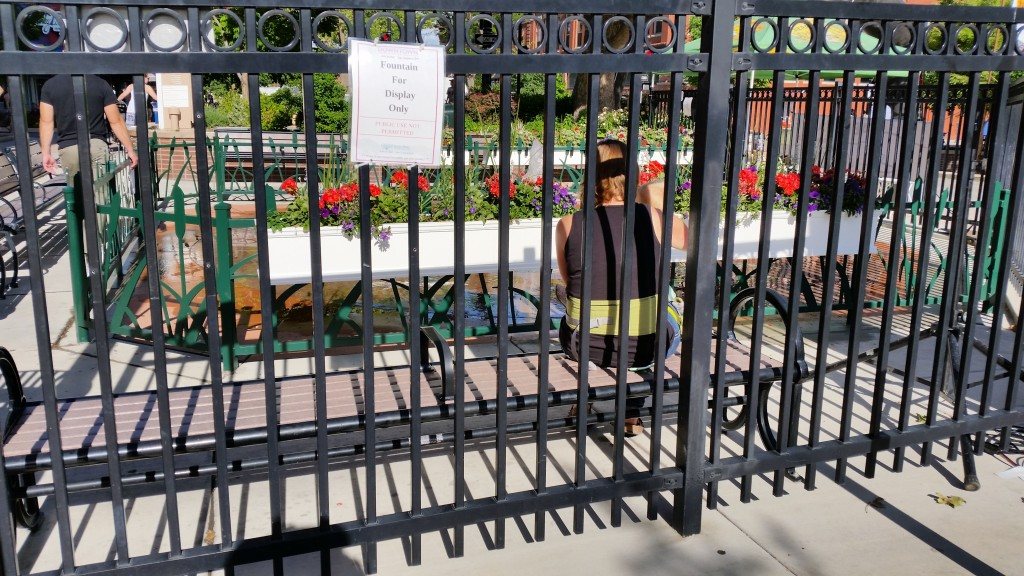 The City of Grand Junction has done its best to lock people out of the formerly well-loved Splash Pad, an interactive fountain originally constructed for people to play in downtown on warm spring and summer days.  The splash pad proved too popular, however, leading to problems of overcrowding and bacteria-filled water. So the City shut it down in July of 2014, and now people must pay to use the splash pad at the Lincoln Park Pool.