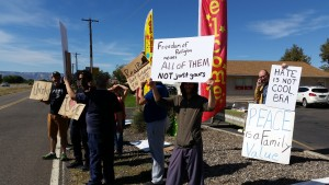 Anti-Islamaphobia rally participants hold signs in Grand Junction