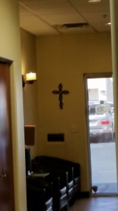 A cross on prominent display in a local chiropractic office