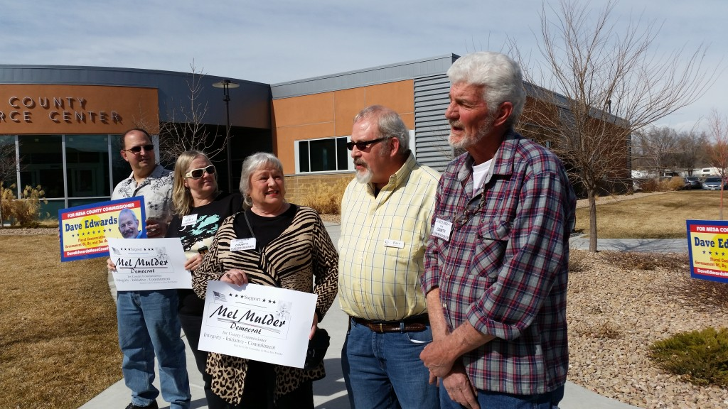 Dave Edwards of Palisade (yellow shirt) and Mel Mulder of Fruita (plaid shirt) announce their candidacies for Mesa County Commissioner