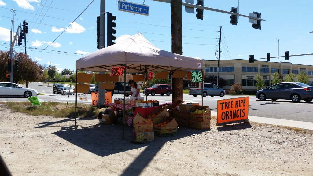The Citrus Gypsies' fruit booth at First Street and Patterson Road