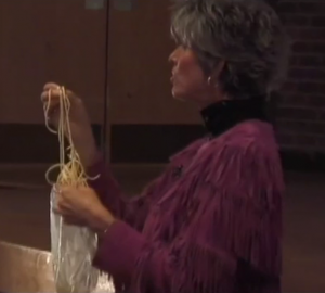 Donahue with her bag of spaghetti, which she uses to illustrate what girls' brains are like