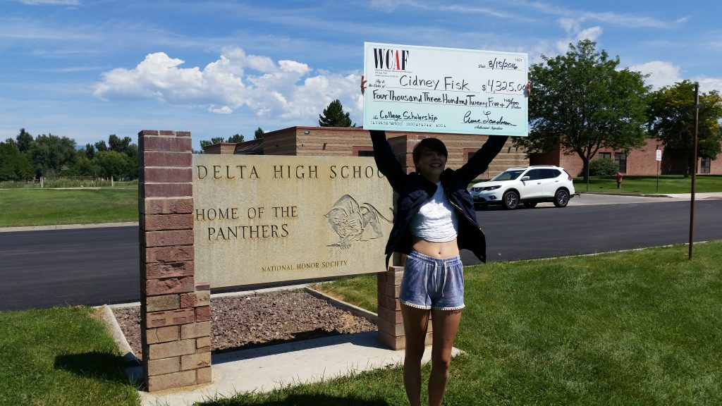Cidney in front of Delta High, with her Big Check from WCAF