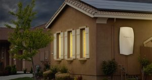 Tesla's Powerwall installed on the side of a house