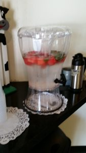 Water, flavored with chunks of fresh watermelon and sprigs of rosemary