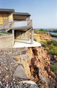 BAD DECISIONS - Mesa County Commissioners approved this Redlands housing development in which setbacks were inadequate to save houses from eventually sliding down the bluff towards the Colorado River